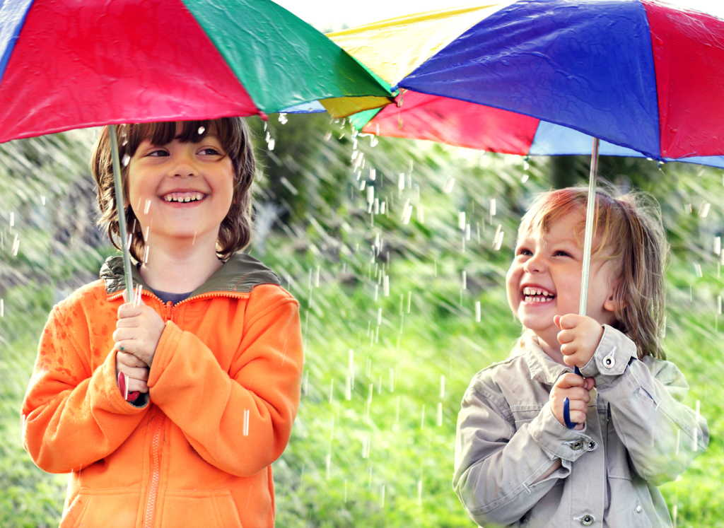 Kids with Umbrella in Rain